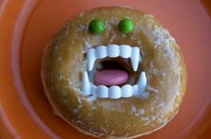 Vampire donuts. Cute and easy! Kids could even help with this. Buy twice the amount of plastic teeth. One for the napkin ring and one for these donuts.