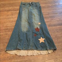 Long denim skirt! Unique long skirt with a slight train (2 inches)! Size 11 but fits more like an 8. Stretchy Jean material. Work onstage for 5 shows but in wonderful condition! America Rocks Skirts Maxi