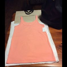 """Banana Republic Tank Top, CORAL. it's new as you may see on the photo it still has the tag on. Boost is 15"""" Length 21""""  94% cotton, 6% spandex Banana Republic Tops Tank Tops"""