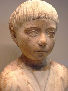 Marble Bust of a Roman Slave Boy named Martial 98-117 CE was dated because of the Trajan-like haircut