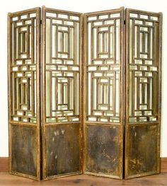 These four panels of Authentic Antique Chinese Doors were originally collected from demolished Buddhist Temples. The doors are handcrafted with Lattice works and structured with wooden pegs and tenon