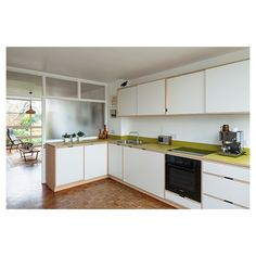 Jocelyn Low : Photographer : Uncommon Projects Kitchen Living, New Kitchen, Kitchen Interior, Kitchen Design, Kitchen Furniture, Plywood Kitchen, Kitchen Wood, 1960s House, Glass Room Divider