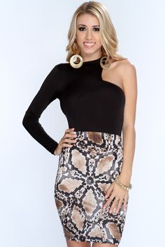 Get dolled up for date night in sexy one of a kind dress! Make them all fall in love with your style when you appear in this provocative look! Show off your style and add it to your wardrobe collection! It features snake print, one long sleeve, cut out sleeve, and tight fitted. 96% Polyester 4%Spandex. Made in USA.