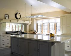 Those Brts again - Mirrors or windows at stove - why not windows under a great hood like this?