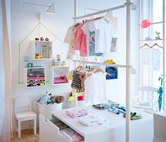 Display of children's clothes using STOLMEN storage solution with drawers and clothes rails