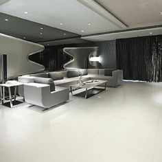 Interior designed lounge feature pure white extra-large thin porcelain tiles by Porcel-Thin