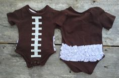 Brown short sleeve body suit with white football laces on the front and white…