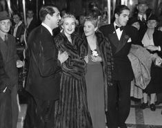 """Cary Grant at the premiere of """"Gunga Din"""" with Phyllis Brooks and Tyrone Power, Jr."""