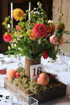 you can make this centerpiece (flowers + container + base) for less than $20 per table. email me for how to: caitgoett@gmail.com