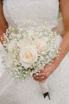 A simple bouquet of ivory roses and baby's breath. Photo via Project Wedding A simple bouquet of ivory roses and baby's breath. Photo via Project Wedding Bridal Flowers, Flower Bouquet Wedding, Bouquet Of Roses, Simple Wedding Bouquets, Ivory Rose Bouquet, Baby Bouquet, Vintage Wedding Bouquets, Bridal Boquette, Boquette Flowers