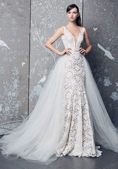 Lace gown, deep V-illusion neckline, V-back, and a skirt with chapel train. Detachable overskirt and beaded belt. | Romona Keveza| Style #L8153
