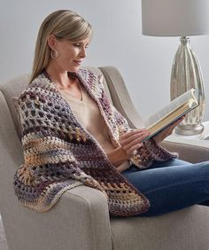 If you're looking for free crochet shawl patterns Red Heart designs, definitely check this one out. It's a seriously snuggly wrap you'll love to cuddle in.