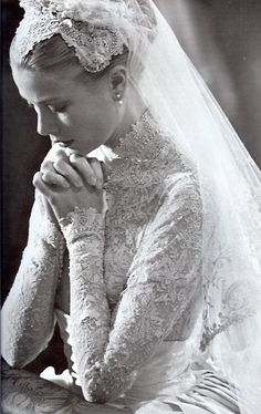Grace Kelly Wedding. I'm kind of a fan of the lace on top, silk wrap around the middle and the silk down to the bottom. Not necessarily the intense veil or turtleneck...