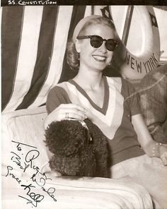 iheartgracekelly: Grace with her gorgeous smile, her amazing sunglasses on the USS Constitution (via tracylord)