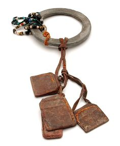 Africa | Upper arm amulet bracelet from the Tuareg people of Niger.  Zinc, glass beads and leather | 20th century