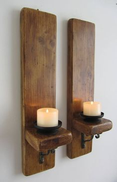 Pair of reclaimed plank wood wall sconce candle holders with antique cast iron brackets Pair of rustic wall sconces with removable black metal candle holders. Made from reclaimed thick planks wit Rustic Wall Lighting, Rustic Wall Sconces, Candle Wall Sconces, Rustic Walls, Rustic Wood, Wood Sconce, Rustic Barn, Lighting Ideas, Deco Originale