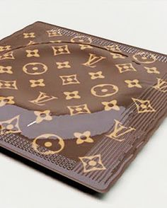 "Georgia Republic architect Irakli Kiziria has designed a Louis Vuitton condom, enveloped in the label's notorious brown packaging and adorned with what looks like raised lettering (for enhanced pleasure?). The luxury rubbers are priced at $68 each, according to the ""official"" website.    To put the price in perspective, $68 could buy you about six 12-packs of regular condoms."