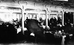This is believed to be the only existing photograph of the Titanic's First Class Dining Room during a meal.