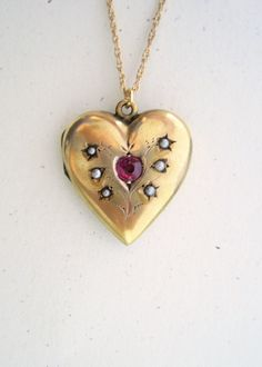 Edwardian Victorian gold filled heart locket with inset paste ruby and natural seed pearls #victorian #locket #jewelry