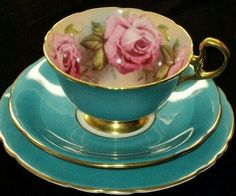 Such a beautiful teal tea cup & saucer with the cup lined with pink roses. (These remind me of my grandmother, she had a beautiful collection of bone china cups with saucers. Teapots And Cups, China Tea Cups, My Cup Of Tea, Chocolate Pots, Vintage China, Vintage Teacups, Antique China, Tea Cup Saucer, High Tea