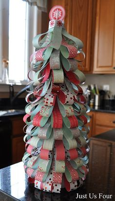 With some scrapbook paper, a Styrofoam tree and pins, you can easily create a gorgeous paper Christmas tree that is perfect for decorating the house.