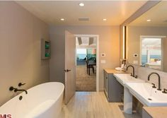 To a gorgeous soaking tub in the master bedroom.