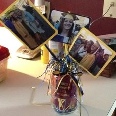 Center pieces for grad party using ribbons, metals and pics of graduation day.