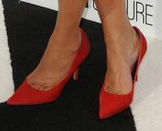 Kris Jenner in red suede pumps at the E! Upfront Presentation in New York City on April 22, 2013