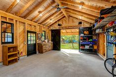 Rustic Garage And Shed by King Building & Remodeling LLC in Boise, Idaho.  room for square dance party at back of garage.