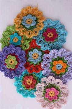 Lovely crocheted flower work via Eugenia on Flickr.