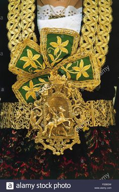 Belt (brezi) made from plates joined at the center by a hand-engraved clasp depicting a religious image, most notably saints from the Eastern church and protectors of Piana degli Albanesi. Detail from a traditional Arberesh (Italo-Albanian) costume, Sicily, Italy. Stock Photo