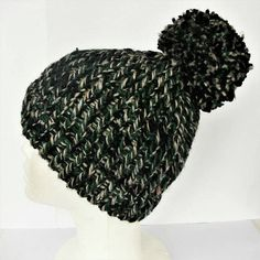 Check out this item in my Etsy shop https://www.etsy.com/uk/listing/537226917/green-bobble-hat-black-bobble-hat