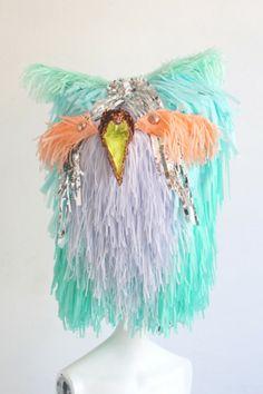 CONFETTISYSTEM for Opening Ceremony. Custom fringed exotic bird head for OCNY at 35 Howard. Photo by CONFETTISYSTEM.