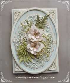 """Creative Expressions Copenhagen, showing the MFT Wild Greenery leaves the Memorybox Fabulous Phlox. The """"corners"""" come from the Creative Expressions set Madison Square."""