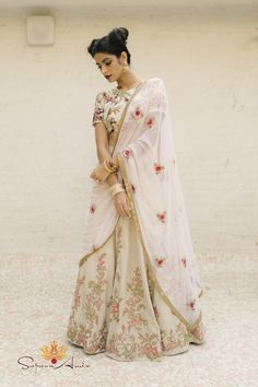 Vintage floral & fruit basket printed blouse highlighted with hand embroidered sequins work. Beige silk skirt with floral embroidery (with full can-can), blush soft net dupatta with hand embroidered flowers and gold border. Floral Lehenga, Lehenga Choli Online, Lehenga Saree, Anarkali, Sari, Indian Dresses, Indian Outfits, Black And Gold Lehenga, Embroidered Silk