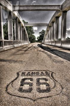 Route 66 Attractions | ROUTE 66-KANSAS- A Route 66 road marker is painted on the asphalt at ...