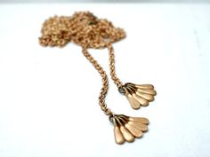 Long brass tassel necklace  vintage drops on raw brass  by illusy, $25.00
