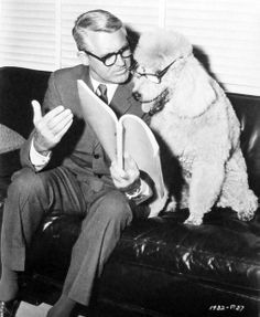 "Cary Grant gives advice to Monsieur Cognac, canine star of ""Wild and Wonderful,""  1964"