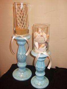 Beach theme.  Hurricane vases on candle holders