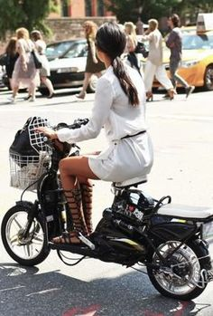 Look chic in a white playsuit while riding around town / the love assembly