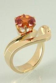 14kt yellow gold design with a 8mm Padparadschah (created) Sapphire
