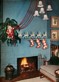 Vintage photo of a living room decorated for Christmas, via Dougsploitation Holiday Dream House.