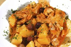 Stoccafisso accomodato, Liguria. (stewed stockfish) allowed for another specialty that is prepared with onions,  garlic, parsley, tomatoes, potatoes, pine nuts and  Taggiasche olives.  (Ph. © Paolo Picciotto)