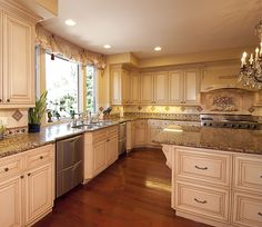 Granite - complex, Laminate, Island, Traditional, Custom Hood/Ventilation, Raised Panel, L-Shaped, Undermount