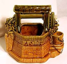McCoy Wishing Well planter with original chain. Signed