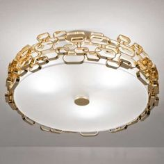 The Glamour ceiling light by Terzani was designed by Dodo Arslan. The Glamour ceiling light consists of much geometric metal shaped rings seductively placed to create a sensuous glow. Every ring has been hand-made and specifically placed creatin. Glass Ceiling, Flush Mount Ceiling, Flush Mount Lighting, Ceiling Lights, White Ceiling, Wall Lights, Luxury Lighting, Interior Lighting, Glamour