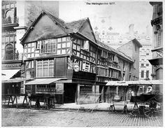 The Wellington Inn, Manchester, 1877 by archivesplus Manchester Street, Manchester England, Manchester Buses, Old Pictures, Old Photos, Manchester Cathedral, Old M, Rochdale, Salford