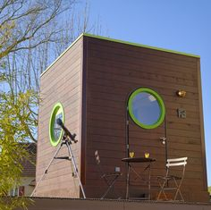the 10 x 10 x 10 Carre d'etoiles portable prefab cube from France, sleeps four people and has parquet floors.