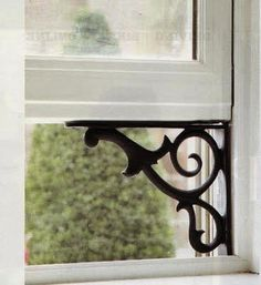 great idea - use outdoor plant hanger to hold up window - pretty cottage idea