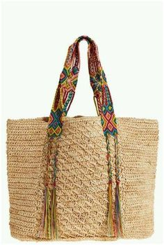 A bohemian take on the classic beach bag, this raffia tote is updated with ethnic inspired accents. Multi colored woven straps on natural raffia provide durable comfort and detail braided tassels for a free-spirited finish. Bag Crochet, Crochet Handbags, Crochet Purses, My Style Bags, Straw Tote, Boho Bags, Craft Bags, Basket Bag, Knitted Bags